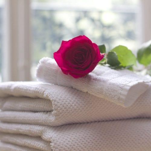 Bulk towel cleaning, towels with rose